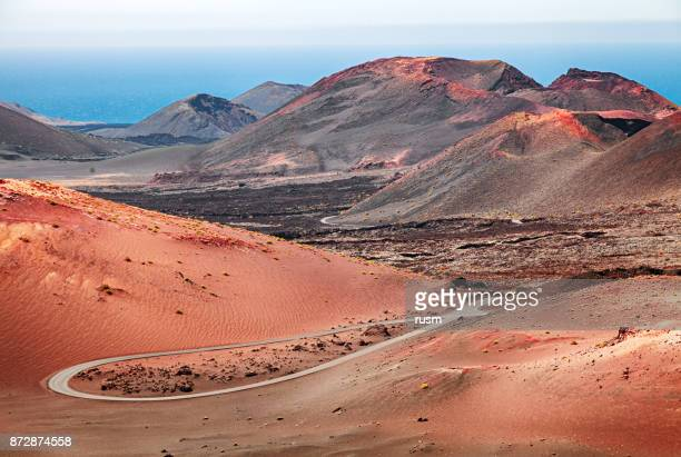 volcanic landscape in timanfaya national park, lanzarote, canary islands - timanfaya national park stock pictures, royalty-free photos & images