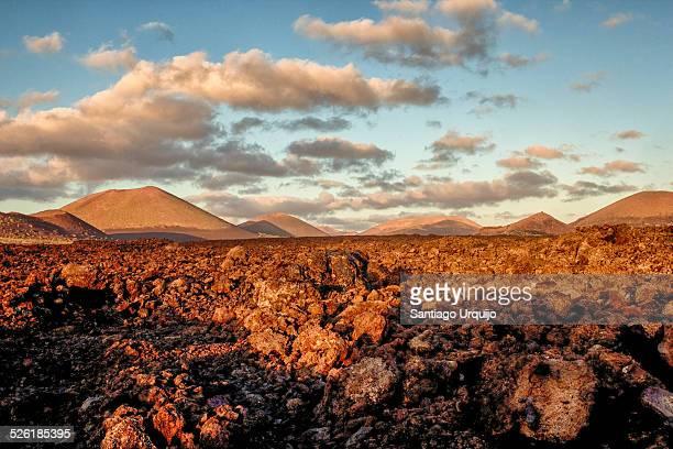 volcanic landscape in timanfaya national park - timanfaya national park stock pictures, royalty-free photos & images
