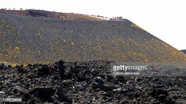 volcanic landscape near the silvestri craters, lateral cones and flow form calderas seen in distance,mount etna, sicily, italy. - vista lateral stock pictures, royalty-free photos & images