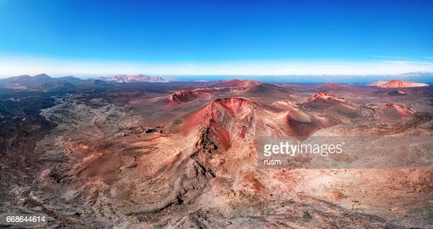 volcanic landscape panorama, timanfaya national park, lanzarote, canary islands - timanfaya national park stock pictures, royalty-free photos & images