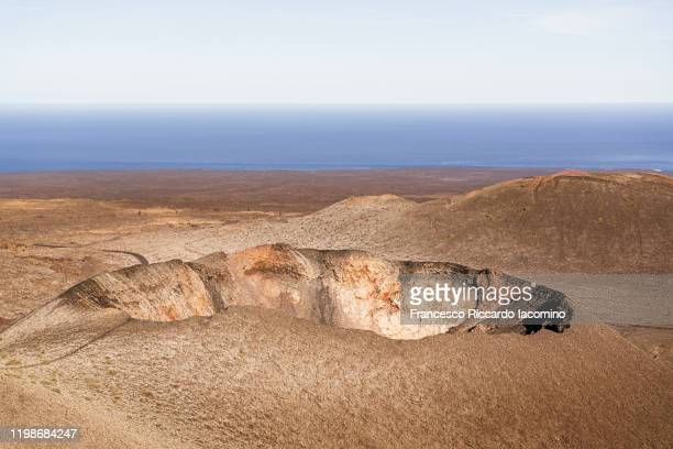 volcanic landscape, timanfaya national park, lanzarote, canary islands - volcanic crater stock pictures, royalty-free photos & images