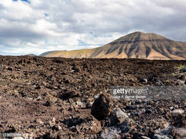 Volcanic landscape with mountains and craters. Lanzarote island, Canary Islands, Spain.