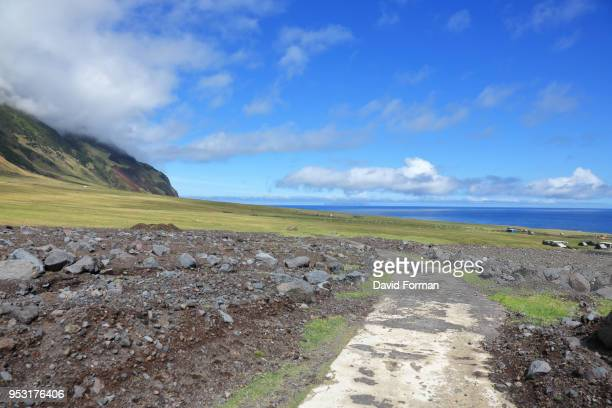 volcanic road from 'edinburgh of the seven seas' to the potato patches on tristan da cunha, south atlantic. - tristan da cunha eiland stockfoto's en -beelden