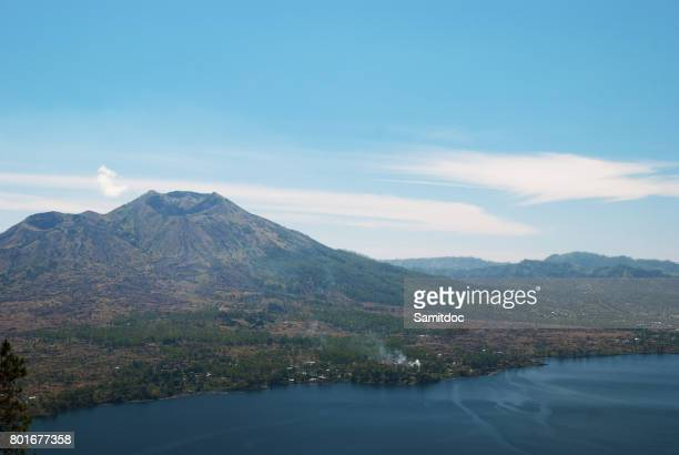 volcano and lake batur etna in bali - lake batur stock photos and pictures