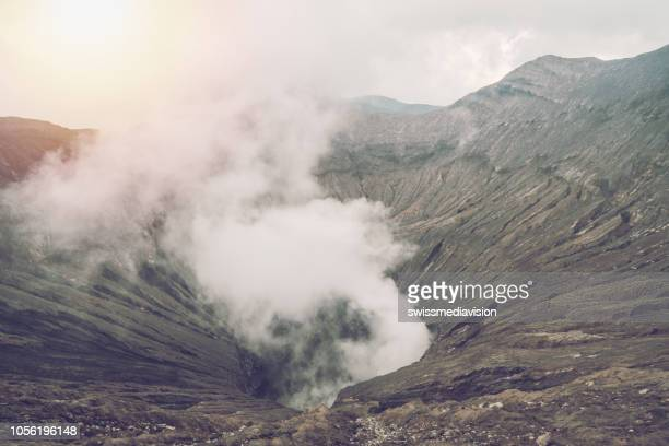 volcano bromo crater edge with steam at mount bromo national park in cemoro lawang village - east java, indonesia, asia. travel destinations adventure nature concept - mt bromo stock pictures, royalty-free photos & images