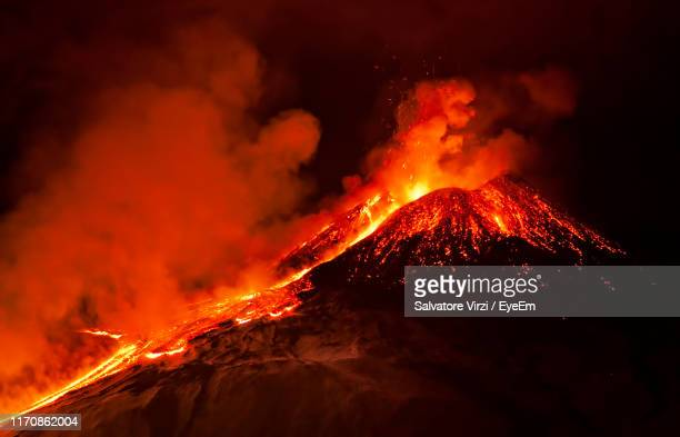 volcano erupting at night - active volcano stock pictures, royalty-free photos & images