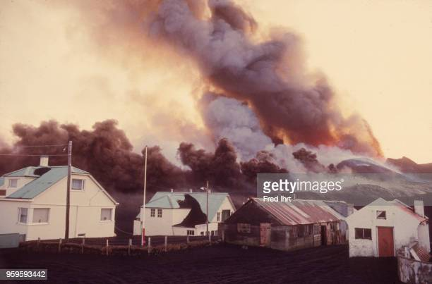 Volcano eruption on Heimaey Island in Iceland on 23 January 1973 Ashes and lava burying homes barns and farmland