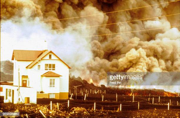 Volcano eruption on Heimaey Island in Iceland on 23 January 1973 Ashes and lava are getting close to homes and farmland