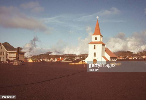 Volcano eruption on Heimaey Island in Iceland on 23 January 1973 Ashes are burying the church