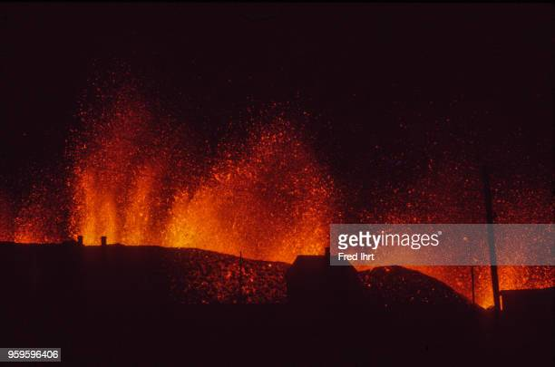 Volcano eruption on Heimaey Island in Iceland on 23 January 1973 Lava and ashes are getting spit up in the air at night