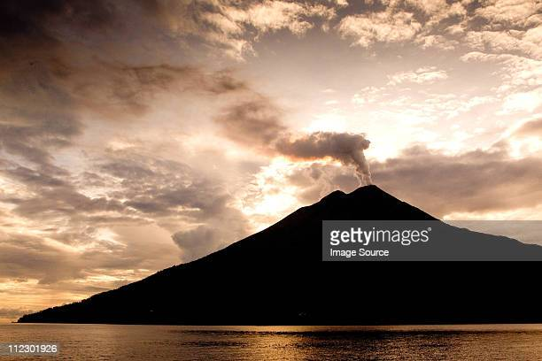 volcano in morning sun - stratovolcano stock photos and pictures