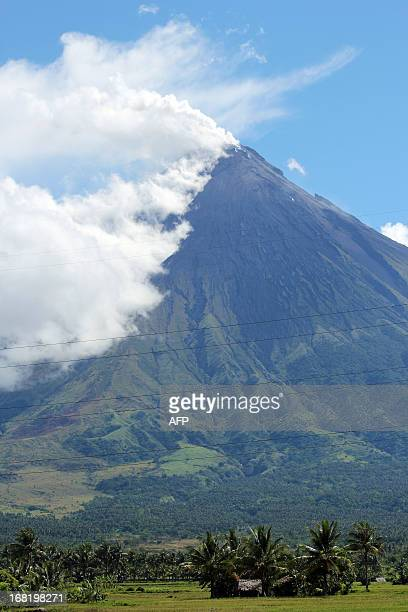 Volcano Mount Mayon spews a thick column of ash 500 metres into the air as seen from the city of Legazpi albay province southeast of Manila on May 7...