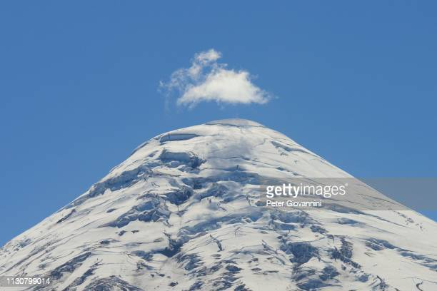 volcano osorno, cloud over summit with snow and ice, region de los lagos, chile - peter snow stock pictures, royalty-free photos & images