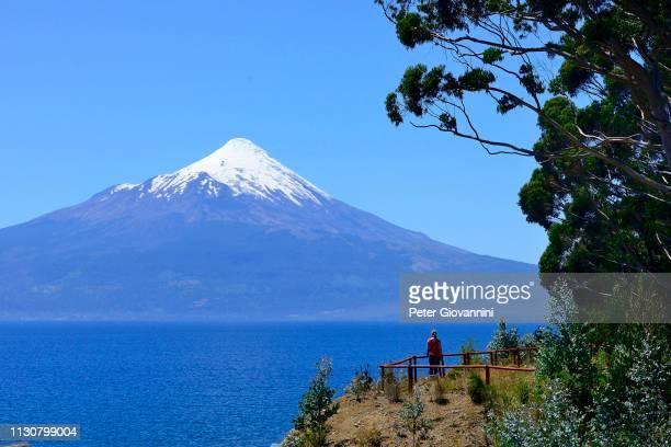 volcano osorno with snow cap at lago llanquihue, region de los lagos, chile - peter snow stock pictures, royalty-free photos & images