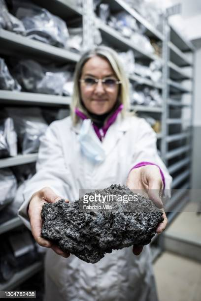 Volcanologist Lucia Miraglia, from the Institute of Geophysics and Volcanology in Catania, in her laboratory as she analyses the ash and lapilli...