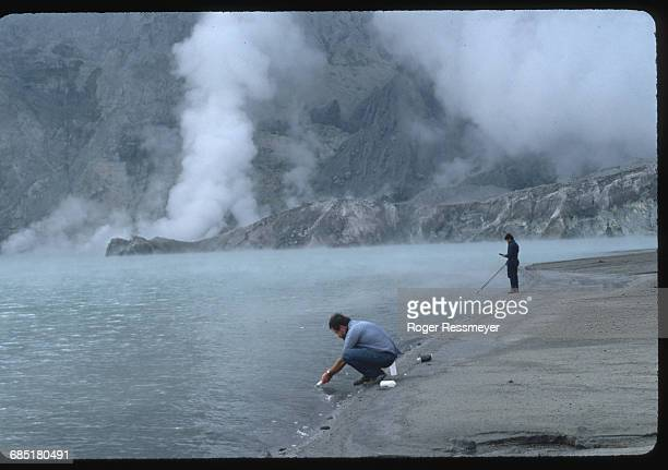 Volcanologists Chris Newhall and Arturo Daag collect water samples from a lake inside Mount Pinatubo's caldera | Location Mount Pinatubo Philippines