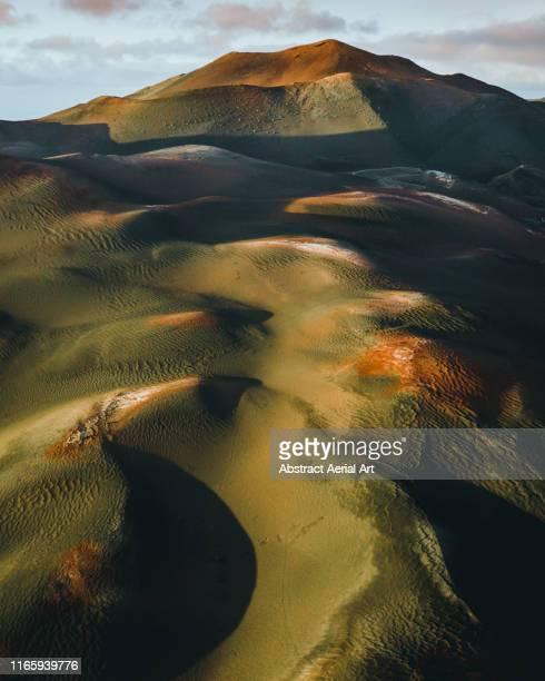 volcanos shot from the air at sunset, lanzarote - unesco werelderfgoed stockfoto's en -beelden