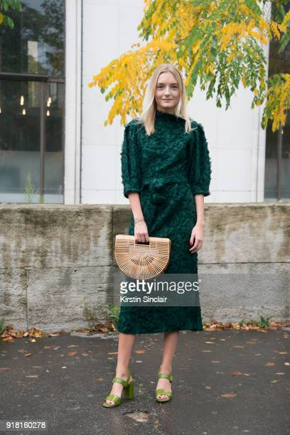 Volga Wolkoff wears a Zara dress Cult Gaia bag and Prada shoes day 6 of Paris Womens Fashion Week Spring/Summer 2018 on October 1 2017 in London...