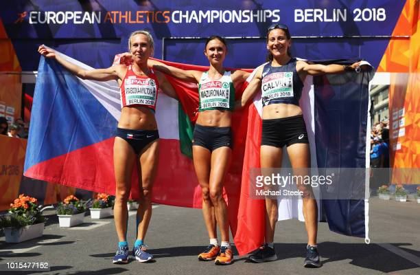Volha Mazuronak of Belarus celebrates as she wins gold with silver medalist Clemence Calvin of France and bronze medalist Eva VrabcovaNyvltova of the...