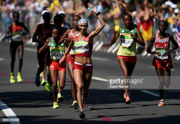 Volha Mazuronak of Belarus pours water on her head during the Women's Marathon on Day 9 of the Rio 2016 Olympic Games at the Sambodromo on August 14...