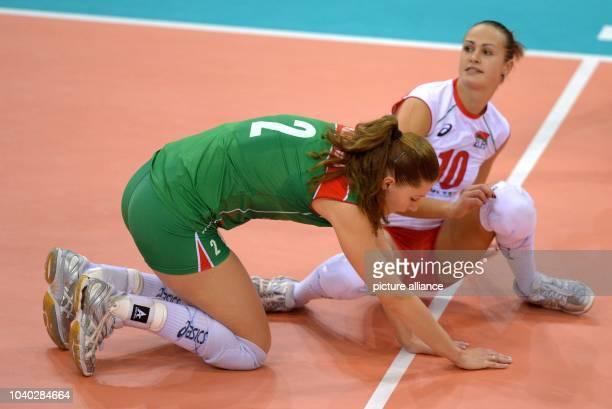 Volha Palcheuskaya and Volha Pauliukouskaya of Belarus react during the women's CEV Volleyball European Championship Group C match between Belarus...