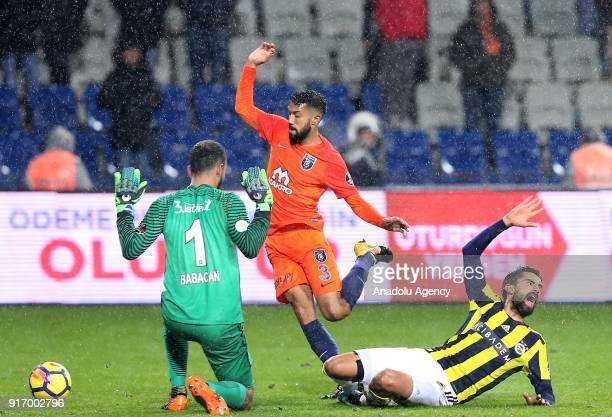 Volkan Babacan and Gael Clichy of Medipol Basaksehir in action against Alper Potuk of Fenerbahce during a Turkish Super Lig soccer match between...