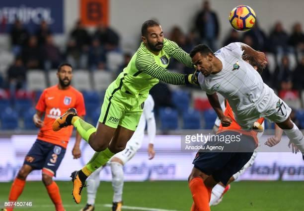 Volkan Babacan of Medipol Basaksehir in action against Sergio Antonio Borges Junior of Teleset Mobilya Akhisarspor during a Turkish Super Lig soccer...