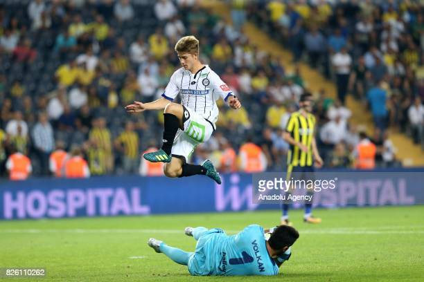 Volkan Demirel of Fenerbahce in action against Roman Schmid of Sturm Graz during the UEFA Europa League third qualifying round 2nd leg match between...