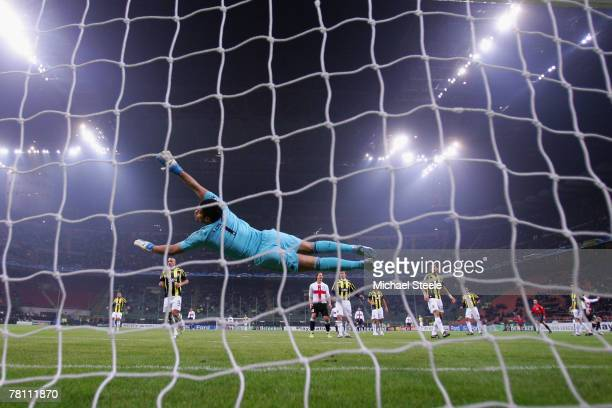 Volkan Demirel the Fenerbahce goalkeeper dives during the UEFA Champions League Group G match between Inter Milan and Fenerbahce at the San Siro...