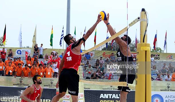 Volkan Gogtepe of Turkey jumps to spike the Mikasa past a blocking Jonathan Erdmann of Germany during the quarter final match in the 5th day of the...