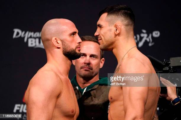 Volkan Oezdemir of Switzerland and Aleksandar Rakic of Austria face off during the UFC fight night weighin at Sajik Arena on December 20 2019 in...