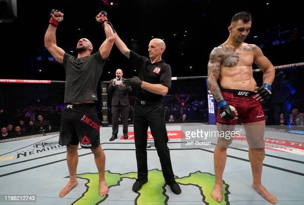 Volkan Oezdemir of Switzerland celebrates after his splitdecision victory over Aleksandar Rakic of Austria in their light heavyweight fight during...