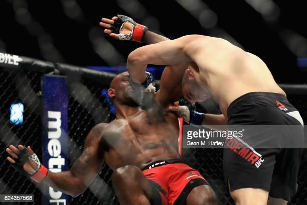 Volkan Oezdemir of Switzerland defeats Jimmy Manua during their Light Heavyweight bout at UFC 214 at Honda Center on July 29 2017 in Anaheim...