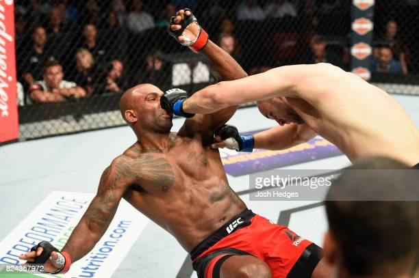 Volkan Oezdemir of Switzerland punches Jimi Manuwa in their light heavyweight bout during the UFC 214 event at Honda Center on July 29 2017 in...