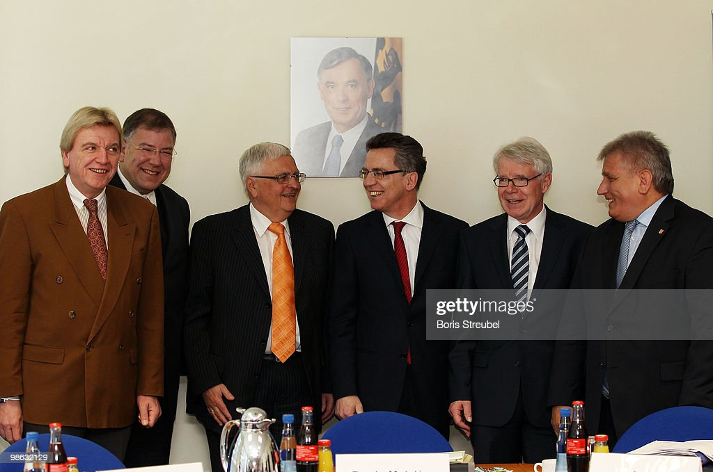 Volker Bouffier, Interior Minister of the German state of Hesse, Christoph Ahlhaus, Interior Minister of the German state of Hamburg and head of the interior minister conference (IMK),Theo Zwanziger, president of the German football association (DFB),Thomas de Maiziere, German Interior Minister, Reinhard Rauball, president of the German Football League (DFL) and Klaus Schlie, head of the sport minister conference and Interior Minister of the German state of Schleswig-Holstein pose for a photo prior to the round table discussion on the subject of 'Gewalt im Zusammenhang mit Fussballspielen' (Violence in football) during the interior minister conference in the ministry of internal affairs on April 23, 2010 in Berlin, Germany.