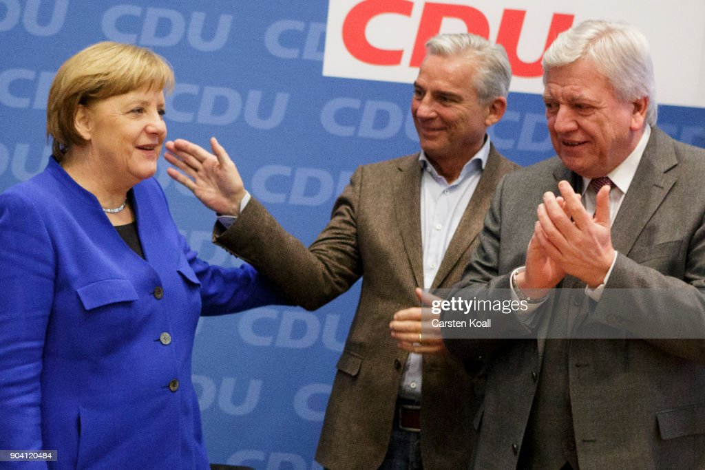 Volker Bouffier, (R), Prime Minister of the Federal State of Hessen, and Thomas Strobl (C) applaud German Chancellor and leader of the German Christian Democrats (CDU) Angela Merkel (L) at the beginning of a meeting of the CDU leadership following all night talks with the German Social Democrats (SPD) and the Bavarian Social Union (CSU) on January 12, 2018 in Berlin, Germany. The three parties were holding preliminary talks over the creation of a possible German government coalition and announced the talks succeeded. The parties will likely soon hold coalition negotiations.