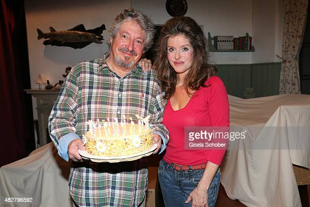 Volker Brandt and his partner Susanne Meikl with a birthday cake during the 80th birthday celebrations for Volker Brandt at Komoedie on August 02...