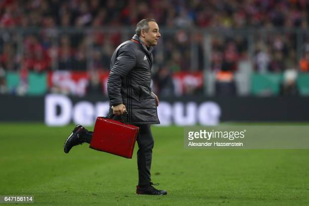 Volker Braun team Doctor of Bayern Muenchen runs during the DFB Cup quarter final between Bayern Muenchen and FC Schalke 04 at Allianz Arena on March...