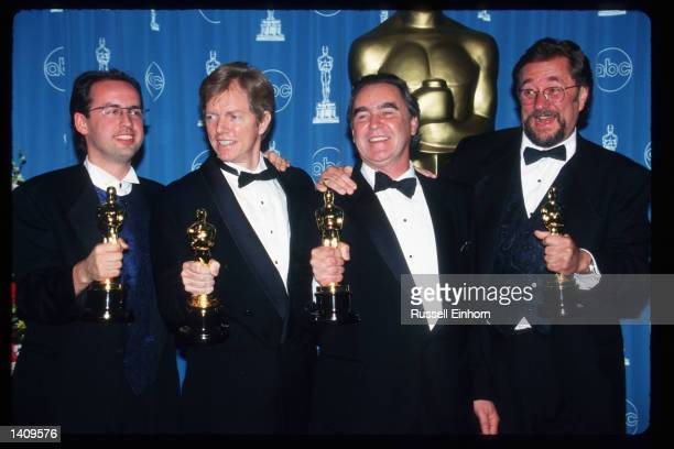 Volker Engel, Douglas Smith, Clay Pinney, and Joseph Viskocil hold their awards at the 69th Annual Academy Awards ceremony March 24, 1997 in Los...