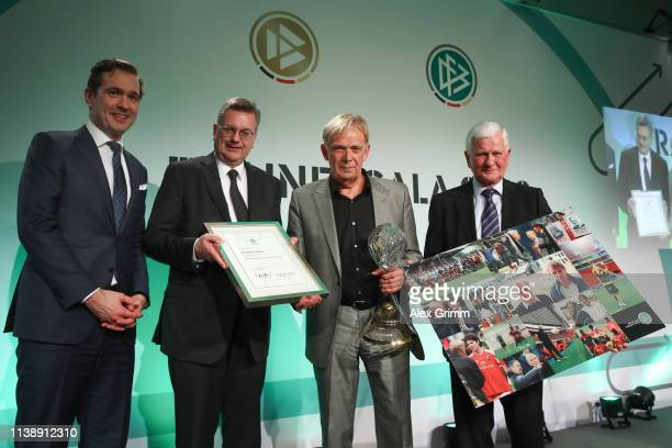 Volker Finke poses with DFB Secretary General Friedrich Curtius, DFB President Reinhard Grindel and Lutz Hangartner after receiving the lifetime...