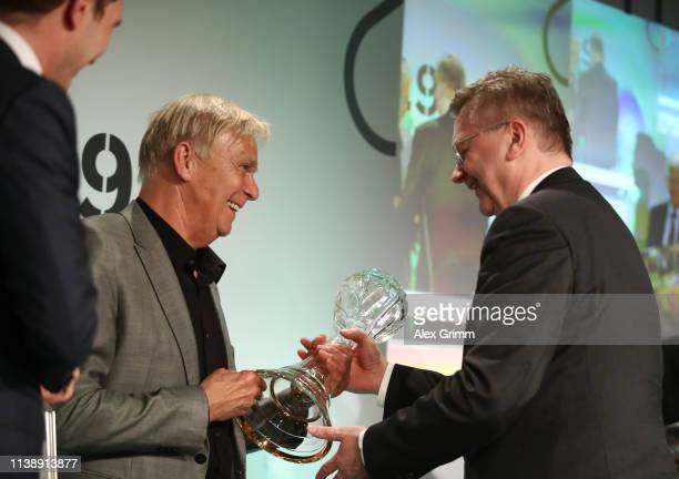 Volker Finke receives the lifetime achievement award from DFB President Reinhard Grindel during the Coaching Award Ceremony & Closing Event of the...