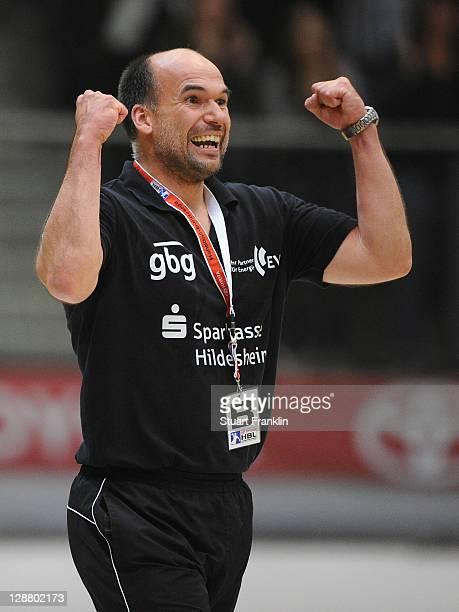 Volker Mudrow, head coach of Hildesheim celebrates his team's first win of the season during the Toyota Handball Bundesliga match between Eintracht...