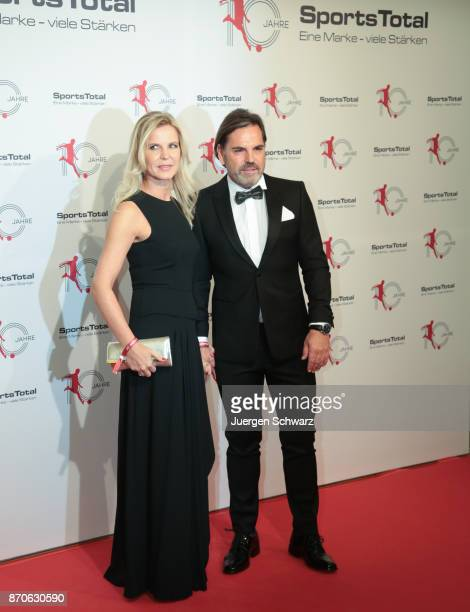 Volker Struth and his girlfriend Melanie pose at the 10th anniversary celebration of the Sports Total Agency on November 5 2017 in Cologne Germany
