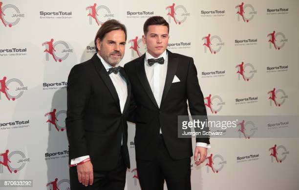 Volker Struth and his son Luca pose at the 10th anniversary celebration of the Sports Total Agency on November 5 2017 in Cologne Germany