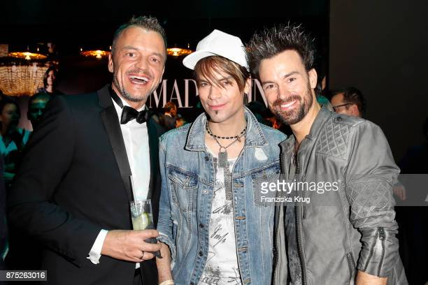 Volker Valk and brothers Andreas Ehrlich and Christian Ehrlich pose at the Bambi Awards 2017 party at Atrium Tower on November 16 2017 in Berlin...