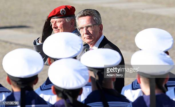 Volker Wieker chief of staff of the Bundeswehr and German Defense Minister Thomas de Maiziere review new German Bundeswehr soldiers during a...