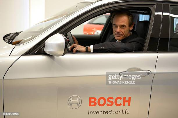 Volkmar Denner CEO of German car supplier Robert Bosch GmbH poses in a BMW E 91 a concept car for automated driving during the company's annual press...