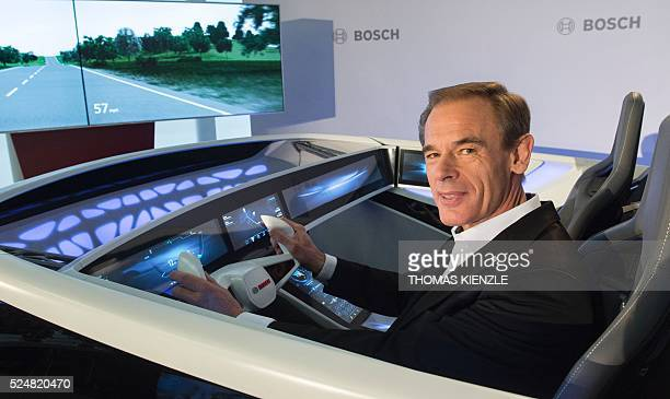 Volkmar Denner CEO of German engineering and electronics company Bosch poses in a concept car for connected driving at the company's annual press...