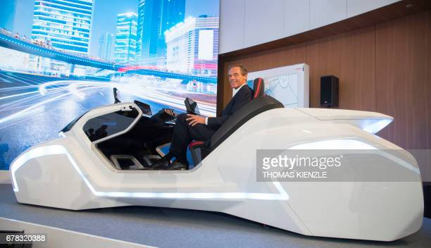 Volkmar Denner CEO of German technology concern Bosch poses in a concept car prior to the company's annual press conference at the Bosch Technology...