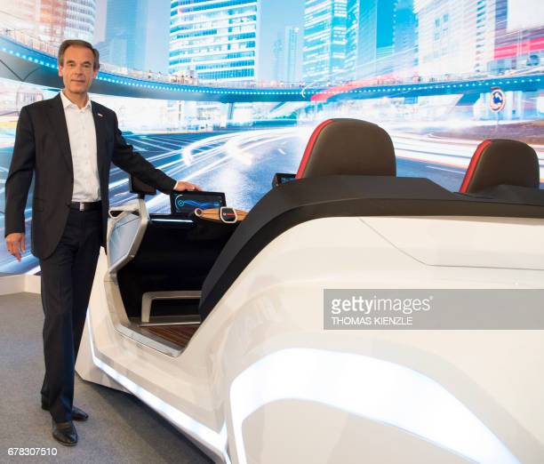 Volkmar Denner CEO of German technology concern Bosch poses next to a concept car prior to the company's annual press conference at the Bosch...